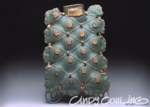 Handbuilt clay bottle. 'Random Acts of Madness'. Decorated with copper wire and brass beads.